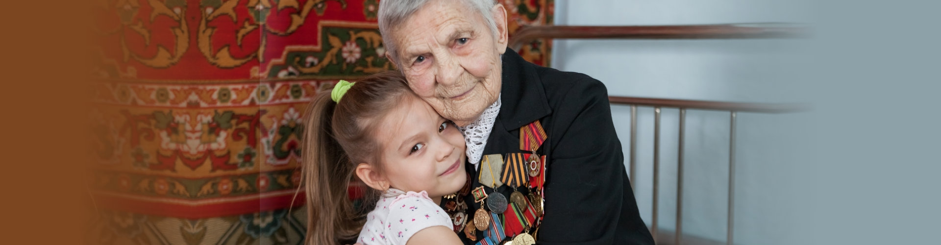 vetaran hugging a little girl