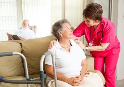 nurse comforting her senior patient